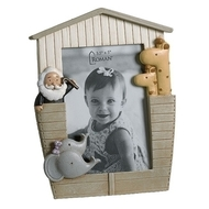 """6""""H """"Noah's Ark"""" Ark shaped Photo Frame.  This Ark Shaped Photo Frame is adorned with elephants and giraffes on either side of the ark  frame. The Ark Shaped Frame is made of a resin/stone mix. The 6H"""" photo frame holds a 3.5H"""" x 3""""W photo."""