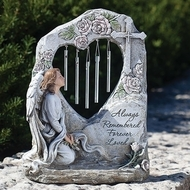 "Memorial Angel Garden Chime. The Memorial Angel Garden Chimes are made of a resin/stone mix. Written on the front of the chimes is; ""Always Remembered, Forever Loved.""  The dimensions are: 11.25""H X 8.75""W X 4.25""L."