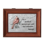 "Cardinal Bird Bereavement Music Box. Lid of the box has a Cardinal on a branch with the words ""When a cardinal appears in your yard it is a visitor from heaven."" Music Box plays ""Nocturne"".  Measurement: 3""H x 6""W x 8""D. Made of Plastic and Metal"