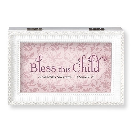 """Bless This Child White and Pink Music Box.  The lid has the words """"Bless this Child~for this child I have prayed.""""  Music Box plays """"Jesus Loves Me."""" Measurement: 6.125""""L X 4""""W X 2.625""""H. Made of Plastic and Metal"""