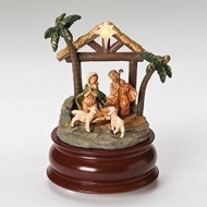 """Battery operated 5.75""""H Musical LED Stable with Holy Family. The musical nativity scene plays O Holy Night. Nativty scene is made of a resin material. Batteries not included."""