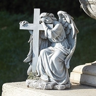 "Angel Leaning on a Cross. This 10""H Angel Leaning on a Cross Garden Statue is made of a resin/stsone mix."