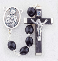 "Black Boxwood Beads Rosary. 7 x 8mm black oval carved boxwood beads rosary has a silver oxidised Sacred Heart of Jesus Centerpiece and the cross is wood with silver oxidised corpus. Rosary measures 19""."