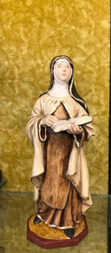 """Saint Theresa of Avila Statue by Liscano.  This statue of Saint Theresa of Avila is made in Colombia, South America. The statue of St. Theresa of Avila has been beautifully hand painted by the Widows of Colombian Violence.It's measurements are  9""""H  x 3"""" round diameter base."""