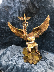 "St Raphael the Archangel Statue by Liscano. This statue of St Raphael the Archangel is made in Colombia, South America. The statue of St Raphael the Archangel has been beautifully hand painted by the Widows of Colombian Violence.It's measurements are  10""H  x 3"" round diameter base."
