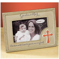 "Godmother Photo Frame. The Godmother Photo Frame has a cross on the bottom right side of frame. The words ""Chosen with love to guide me in faith"" is written across the bottom of the photo frame. Godmother Photo Frame measures 6.75""W x 5""H. This resin photo frame holds a 2.75"" x 4.5"" photo and has an easel backer for easy standing up."