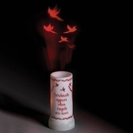 Plastic LED projector candle decorated with red cardinals and the words 'Cardinals Appear When Angels Are Near' and projecting red cardinals on the ceiling above.