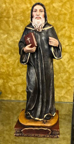 """St Charbel Statue by Liscano Saint Charbel Makhlouf or Sharbel Maklouf was raised by his widowed mother, she later remarried a man who went on to seek Holy Orders and became the parish priest of the village. Youssef was raised in a pious home and became drawn to the lives of the saints and to the hermit life, as was practiced by two of his uncles. As a young boy, he was responsible for caring for the family's small flock. He would take the flock to a grotto nearby, where he had installed an icon of the Blessed Virgin Mary. He would spend the day in prayer. In 1875, Charbel was granted by the abbot of the monastery the privilege of living as a hermit at the Hermitage of Sts. Peter and Paul, a chapel under the care of the monastery. He spent the next 23 years living as a solitary hermit, until his death from a stroke on Dec 24, 1898 from has been beautifully hand painted by the Widows of Colombian Violence. It's measurements are  9""""H  x 3"""" round diameter base."""