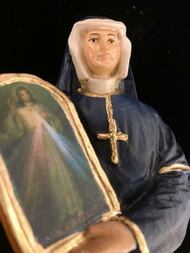 """St Maria Faustina Statue (Divine Mercy) by Liscano.  This statue of St Maria Faustina is made in Colombia, South America. The statue of St Maria Faustinahas been beautifully hand painted by the Widows of Colombian Violence. It's measurements are  8""""H  x 3"""" round diameter base."""