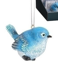 """2.5"""" Bluebird of Happiness Ornament. The Blue Bird of Happiness is made of resin.  The blue jay resonates truth, faithfulness, and solidarity because they are vigilant in their tasks. They also keep the same mate for life, which is symbolic of endurance, patience and loyalty.  Card on back of the box reads:  """"Let this little Bluebird hang on your tree, to remind you of the nest that shaped you into who you would be. Adventures and flights might keep you at a distance, but true happiness is found in a trip home for Christmas"""""""