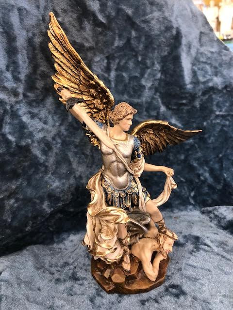 """Beautifully detailed St Michael the Archangel Statue by Liscano. This statue of St Michael the Archangel is made in Colombia, South America. The statue of St Michael the Archangel has been beautifully hand painted by the Widows of Colombian Violence. It's measurements are  9""""H  x 3"""" round diameter base."""
