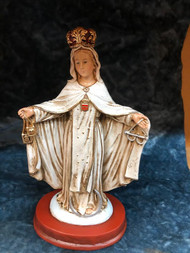 "Our Lady of Mercy Statue by Liscano.  This statue of  Our Lady of Mercy statue is made in Colombia, South America. The statue of Our Lady of Mercy has been beautifully hand painted by the Widows of Colombian Violence. It's measurements are  9""H  x 3"" round diameter base."