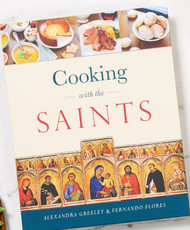 For the Love of Food, the Church, and Her Saints! From traditional Cottage Pie on St. Patrick's Day to Basque Lamb Stew on the feast of St. Ignatius Loyola, the delicious recipes in this unique cookbook will excite your senses, awaken in you greater love for the saints, and bring Catholic festivity into your home.  Here you'll find brief saints biographies and ideal accompanying dishes tied to the liturgical feasts of the Church. From this exceptional cookbook, your family will receive triple nourishment: for body, mind, and spirit.  In it, you'll encounter:  Scores of exciting dishes from dozens of countries, including Ethiopia, Spain, Poland, Hungary, Korea, Scotland, France, Greece, and Sweden. Sixty fascinating saints biographies. A comprehensive list of celebratory cookies for feast days throughout the year. Many traditional recipes, including Roman Honey Cake, Hungarian Goulash Soup, and even Papal Cream Cake (a favorite of St. John Paul II). A handy index to help you find just the kind of dinner you need tonight. A carefully categorized shopping list for each recipe, to save you time in the store. Gathered by Alexandra Greeley, a professional chef and author of thirty-five cookbooks, and Fernando Flores, a world traveler and aficionado of all things relating to food and faith, each of these succulent recipes has been home-tested by our team of Christian mothers and their families.  With the help of Cooking with the Saints, you'll turn every Christian feast into a joyous, faith-filled occasion, bringing your family gastronomic delight and spiritual enrichment throughout the year.  Among the saints celebrated in this book, you'll meet:  St. Aloysius Gonzaga St. Anselm of Canterbury St. Basil the Great St. Brigid of Kildare St. Catherine of Siena St. Damien of Molokai St. Isidore the Farmer St. Joan of Arc St. John Neumann St. Josemaría Escrivá St. Junípero Serra St. Justin Martyr St. Kateri Tekakwitha St. Mark the Evangelist St. Mary of Egypt St. Padre Pio St. Paul Miki St. Simon Stock St. Teresa of Calcutta St. Thérèse of Lisieux St. Thomas Aquinas