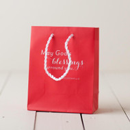 """This Little Red Gift Bag is perfect for all occasions. Message: May God's Blessings Surround You Gift Bag Details: Size:  6 3/4""""H x 5""""W x 2 3/4""""D Value small bag Sturdy rope handles Coated pape"""