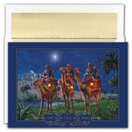 "WISEMEN AT NIGHT. This is a beautiful Christmas card featuring gold foil and an embossing. Inside Sentiment: MAY YOU HAVE THE GIFT OF FAITH, THE BLESSING OF HOPE AND THE PEACE OF HIS LOVE AT CHRISTMAS AND ALWAYS.""  Box contains 18 cards/18 foil lined envelopes. Folded Card Size: 5.625"" x 7.875"". Packaged in a printed box with an inside fit acetate lid."