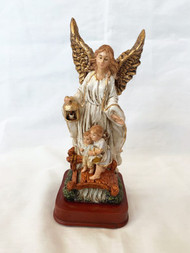 "A beautifully detailed and hand painted Guardian Angel and Children on Bridge Statue by Liscano. This statue of St Guardian Angel and Children on Bridge is made in Colombia, South America. The statue of the Guardian Angel and Children on Bridge has been beautifully hand painted by the Widows of Colombian Violence. It's measurements are  8.25""H  x 3"" square base."