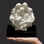 An intimate depiction highlighting the sanctity of the family including the loving stability that grandparents offer our future generations. This solid resin-stone cast is left in its natural Carrara white color and is mounted on a solid matt black base. Timothy personally sculpts every original small masterpiece complete with his signature or monogram. Each replica is detailed by hand to the exacting standards of this modern day master sculptor.  Miniature Replica : (7.25″h x 5.75″w x 6.75″d)