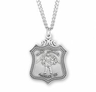 "St. Michael Sterling Silver Shield Medal. Dimensions: 1.1"" x 0.8"" (27mm x 20mm). St Michael Policeman's Badge Medal comes on a 24"" Genuine rhodium plated curb chain with a genuine rhodium-plated chain. Weight of medal: 3.8 Grams. Presents in a deluxe velour gift box. Engraving available at an additional cost"