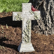 """Cardinal Memorial Cross. The memorial cross stands 16""""H. The Cardinal Cross is made of a resin stone mix. On the memorial cross is written: """"When a cardinal appears an angel is near."""" On the cross is depicted a cardinal sitting on branches with green leaves."""
