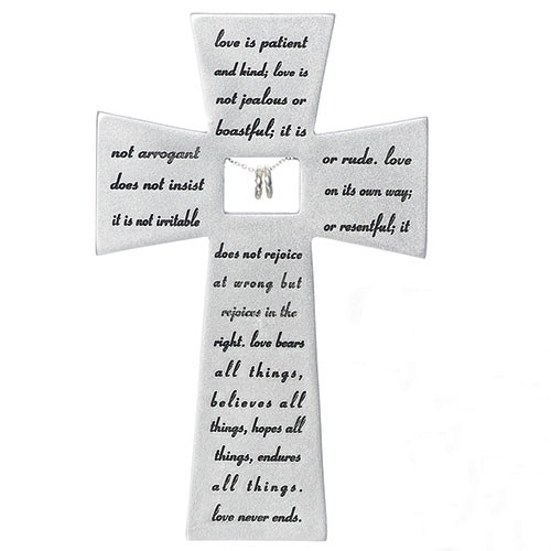 """Love Never Fails Wall Cross is made of a resin stone mix. The Love Never Fails Wall Cross measurements are  7""""H x 4.5""""W x 0.5""""D.  The words on the cross are from Corinthians; Love is Patient and Kind,  Love is not jealous.....Makes a wonderful wedding gift!"""