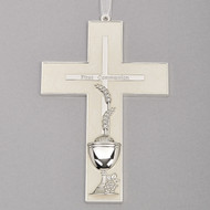 "7""H White Holy Communion Wall Cross. The white communion wall cross has a cross within the cross and wheat, grapes and the chalice are depicted at the bottom of the cross. The words First Communion are also written on the cross. Made of zinc alloy-lead free"