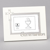 "7""H White Holy Communion Photo Frame. The white communion photo frame has a white enameled cross on the upper left corner with crystals. The word Communion are also written on the bottom. Frame holds a 4"" x 6"" photo. Made of zinc alloy-lead free"