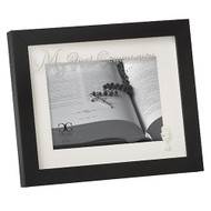 "8""H Black Holy Communion Photo Frame. The black holy  communion photo frame has the words ""My First Communion "" written across the top of the Glass. The picture frame holds a 5"" x 7' photo. . Made of glass and plastic."