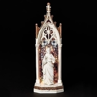 "Sacred Heart of Jesus Arched Window LED Figure. The beautiful figure stands in front of a stained glass window. This figure lights up with 3AAA batteries NOT INCLUDED.  Figure stands 11.75""H and is made of a resin/stone mix."