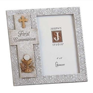"7.25""H Holy Communion Photo Frame. The  holy communion photo frame has the words "" First Communion "" written inside a cross with a wheat and chalice icon at the bottom of the cross. The picture frame holds a 4"" x 6"" photo.  Made of a resin/stone mix."