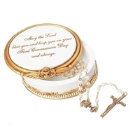 """2"""" White and Gold Holy Communion Keepsake Box. Keepsake box is adorned with a chalice and the words  """"May the Lord bless you and keep you on your Frist Communion Day and always.""""  Box measures 2."""" round. Made of a resin/stone mix. ROSARY NOT INCLUDED!"""
