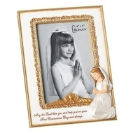 "7""H White Holy Communion Photo Frame. The white communion photo frame has a white enameled cross pn the upper left corner with crystals. The word Communion are also written on the bottom. Frame holds a 4"" x 6"" photo. Made of zinc alloy-lead free"