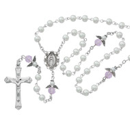 Holy Communion Rosary. This Holy Communion Rosary is made with 5mm white pearl beads and Pink Angel Our Father beads.  Rosary has a rhodium miraculous medal center piece and crucifix. Rosary comes in a gift box!