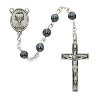 Beautiful First Communion Rosary. This genuine Hematite rosary has a pewter crucifix and a pewter chalice centerpiece.   The rosary comes in a Black Leatherette Gift Box. Perfect keepsake rosary for years to come.