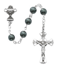 "Beautiful First Communion Rosary. This genuine Hematite rosary has a rhodium crucifix and  chalice centerpiece.  Rosary measures 16 1/2""L.  The rosary comes in a Black Leatherette Gift Box. Perfect keepsake rosary for years to come."