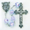 """December - Zircon These 8mm aurora borealis faceted acrylic beads are available in each birthstone month color. Rosaries are 20"""" long. Rosaries have a silver oxidised Madonna centerpiece and Crucifix.  Perfect gift for any occasion."""
