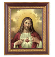 "11"" x 13"" Sacred Heart of Jesus Framed Artwork. Frame is a detailed cherry wood with a gold edging."
