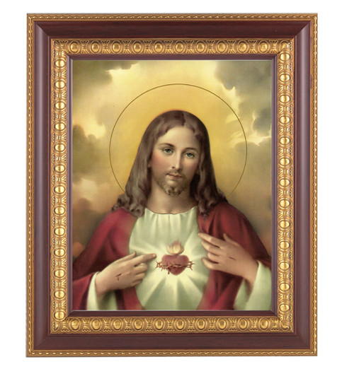 """11"""" x 13"""" Sacred Heart of Jesus Framed Artwork. Frame is a detailed cherry wood with a gold edging."""