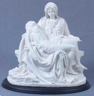 "A beautiful Pieta in white on a black base, 10.5"".  Veronese Statuary"