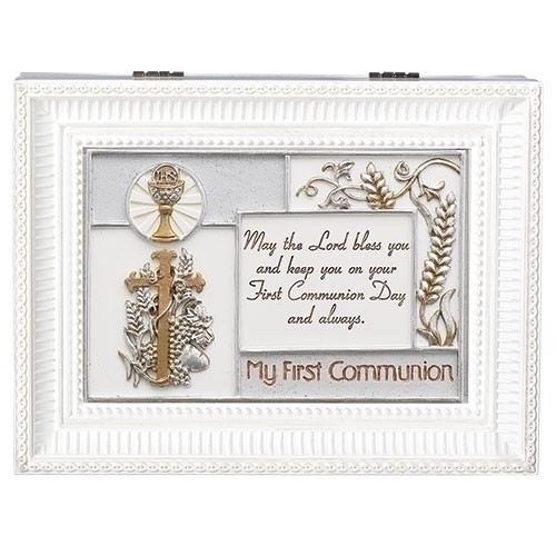 """""""My First Holy Communion"""" White Wind up Music Box. Music Box plays """"Ave Maria"""". Saying reads: """"May the Lord bless you and keep you on your First Communion Day and always."""" Measurement: 8""""L X 6""""W X 3""""H. Made of Plastic and Metal."""