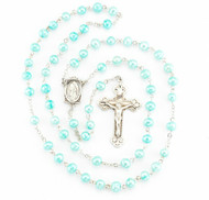 """Rosary made with 6mm blue freshwater pearls. Blue pearl rosary has a detailed sterling silver Miraculous Centerpiece with a 1-7/8"""" sterling silver Crucifix. Rhodium plated brass findings.  Rosary comes with a deluxe velour gift box. Made in the USA."""
