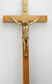 """10"""" walnut stained  crucifix with a gold corpus and INRI. Comes Bagged. Made in the USA."""