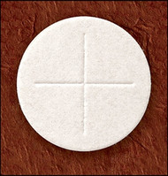 An image of a single communion wafer with a Cross indentation on it.  St Jude Shop has so many different church supplies for sale, including many sizes of altar bread. 1 ⅜ Diameter with Cross Design Available in White or Whole Wheat Offered in quantities of 500 or 1000 Freshly made in Greenville, RI, with pure flour and water with no additives Subject to inspection by the FDA and RI Department of Health Buy altar bread as well as many other church supplies from St. Jude Shop today!