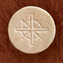 Image of 1 1/2-inch, whole wheat communion wafers with a new cross design.