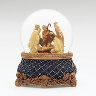 A nativity scene inside a snow globe with baby Jesus, Mary, Joseph, and the Three Wise Men.