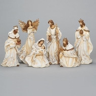 """6 piece Nativity set is in gold and cream colors with some rope trim . Tallest piece measures 12"""". Dimensions are 12""""H x  4.75""""W. Nativity figures are made of a resin material."""