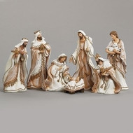 """7 piece Nativity set is 8.5""""H.  The figures have a gold trim fabric look. Dimensions are 8.5""""H x 3.75""""W. Nativity figures are made of a resin material."""