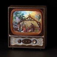 """Musical 9.75"""" LED Swirl TV Nativity.  Dimensions are 9.75""""H x 8.5""""W. V Nativity plays various Christmas Songs. Tv Nativity is made of plastic. The TV uses one USB cord or 3 """"C"""" Batteries NOT INLCUDED"""