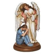 """Guardian Angel withFrmale Healthcare Worker. This angel comforting a female healthcare worker figures sits on a wood platform. Figure measures 7.25""""H. Figure is made of a resin/stone mix. Male version also available 602129"""