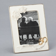 """7.75""""H 50th Wedding Anniversary Frame. Porcelain frame holds a 4"""" x 6"""" photo. The words """"Love is patient, love is kind' are written on the bottom of the frame. Gold #50 is nect to the words. Left hand corner of the porcelain 50th anniversary frame has two porcelain roses.  Actual dimensions are  7.75""""H X 5.75""""W X .75""""L"""