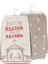 """A set of two Christmas-themed kitchen towels featuring intricate, age-old block carving and printmaking techniques. One towel lends """"Jesus Is The Reason For The Season"""" sentiment with Nativity scene designs and is paired with a coordinating replicated star patterned towel. Complements well with similar block print pieces to make for a festive collection. Machine-washable. Measures 28"""" x 28""""."""